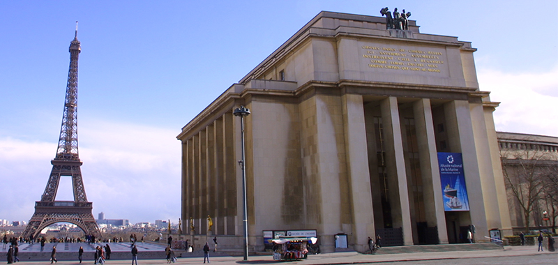 Facade of the Palais de Chaillot and view of the Eiffel Tower